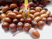 Decorative cat on a acorns background Stock Photography