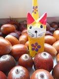 Decorative cat on a acorns background Stock Photos