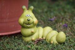 Decorative caterpillar. In the garden vector illustration
