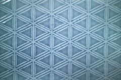 Decorative ceramic blue tile with figured pattern Royalty Free Stock Image