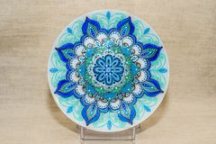 Decorative ceramic dish painted with hands. Art, handmade. Decorative ceramic dish painted with hands. Art, handmade royalty free stock photography