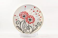 Decorative ceramic dish painted with hands. Art, handmade. Decorative ceramic dish painted with hands. Art, handmade stock photography