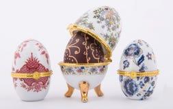 Decorative ceramic Faberge eggs. Isolated on white background Stock Photos