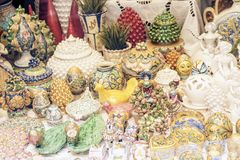 Decorative ceramic and glass plates, figurine, vase and statuette in the souvenir shop in Taormina, Sicily, Italy.  stock photos