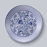 Decorative ceramic plate with a painting. Floral circular pattern in Gzhel style. Stock Images