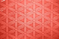 Decorative ceramic tile figured pattern in a trendy color of the year 2019 Living Coral pantone. royalty free stock photo