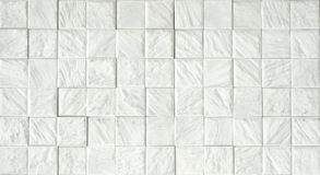 Decorative Ceramic Tiles. White ceramic relief wall tiles for interior use Stock Photo