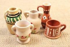 Decorative ceramic vases on jute canvas Royalty Free Stock Photo