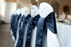 Decorative chair covers. In white with black ribbons royalty free stock image