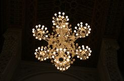 Decorative chandelier. Large decorative chandelier from mosque of Hassan II in Casablanca (Morocco Royalty Free Stock Photo