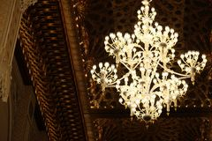 Decorative chandelier in the Mosque of Hassan II. In casablanca morocco, famous mosque landmark, luxurious and shining light, golden decoration background Royalty Free Stock Images