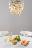 Decorative chandelier and table setting with wine Royalty Free Stock Images
