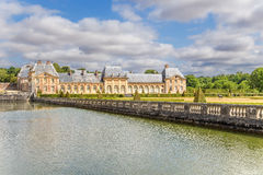 Decorative channel and one of the buildings of the estate of Vaux-le-Vicomte, France Royalty Free Stock Photos