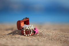 Decorative chest with jewelry and starfish Stock Photos