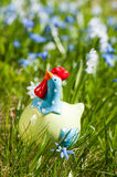 Decorative chicken in the garden Stock Photos