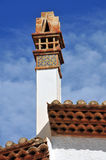 Decorative chimney. A Catalan modernist chimney decorated with hand painted tiles Stock Photo