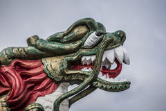 Decorative chinese dragon head. Decorative wooden Chinese dragon head with teeth bared Royalty Free Stock Image