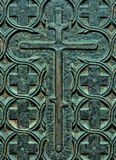 Decorative Christian crosses on the doors of copper. Orthodox signs. Rusty vintage background on the old metal door. Easter, orthodox faith Royalty Free Stock Images