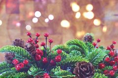 Decorative Christmas background with wreath and bokeh lights Royalty Free Stock Photos