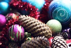 Decorative balls and fir-tree cones close up. Decorative christmas balls and cones close up Royalty Free Stock Images