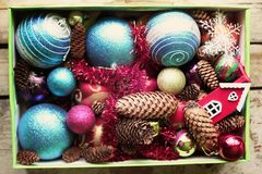 Decorative balls and fir-tree cones close up. Decorative christmas balls and cones close up Stock Images