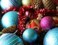 Decorative christmas balls. And fir-tree cones close up Royalty Free Stock Photos