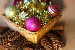 Decorative christmas balls. And fir-tree cones close up Stock Photography