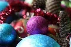 Decorative balls and fir-tree cones close up. Stock Image