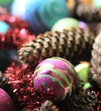 Decorative christmas balls. And fir-tree cones close up Royalty Free Stock Image
