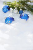 Decorative Christmas balls on the snow and brunch of Christmas tree outdoor. Close up of decorative Christmas balls on the snow and brunch of Christmas tree Stock Photography