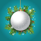 Decorative Christmas bauble background. Decorative Christmas background with bauble against fir tree branches Royalty Free Stock Photos