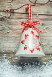Decorative Christmas bell on a rustic background Stock Photos