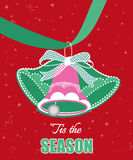 Decorative Christmas Bells. Hanging from ribbon -tis the season message Stock Photo