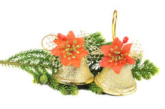 Decorative Christmas bells on a pine branch Royalty Free Stock Image