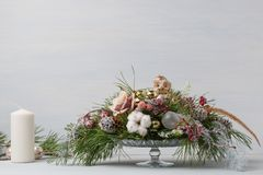 Decorative Christmas bouquet with candles Stock Photo
