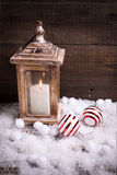 Decorative christmas composition. Burning candle  in lantern and Royalty Free Stock Images