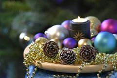 Decorative Christmas composition with candle, balls,. Cones. Coloured dreams for Christmas Time Royalty Free Stock Images