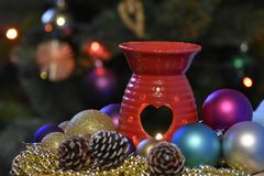 Decorative Christmas composition with candle, balls,. Cones. Coloured dreams for Christmas Time Royalty Free Stock Photo