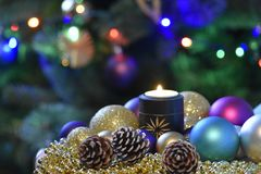 Decorative Christmas composition with candle, balls,. Cones. Coloured dreams for Christmas Time Stock Images