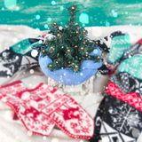 Decorative Christmas composition Christmas Tree Knitted mittens and a scarf. The attributes of the winter holiday. Square royalty free stock photography