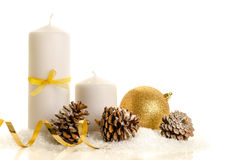 Decorative christmas composition from white candle, pine cones, Stock Photos