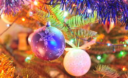 Decorative Christmas globes in the tree Stock Images