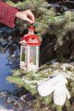 Decorative Christmas lantern in snow winter day Stock Photo