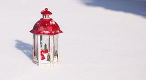 Decorative Christmas lantern in snow winter day Royalty Free Stock Photography