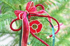Decorative Christmas lucky charm on green tree Royalty Free Stock Image