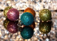 Decorative Christmas ornaments. Decorative Christmas ornament with bokeh background Stock Images