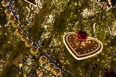 Decorative christmas ornaments baubles on green evergreen branches of a coniferous tree Royalty Free Stock Images