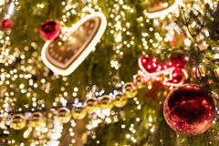 Decorative christmas ornaments baubles on green evergreen branches of a coniferous tree Royalty Free Stock Photo