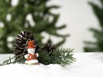 Decorative Christmas ornaments on a snowy stock photo