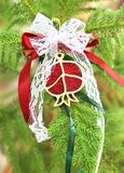 Decorative Christmas pomegranate on tree. Christmas ornaments home decor Royalty Free Stock Images